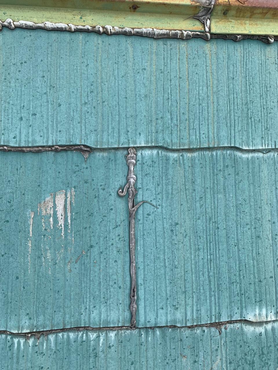 過去に補修したスレート屋根